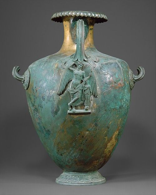 The elegant ovoid shape of this vase and the inclusion of a figural relief under the vertical handle are found on most bronze hydriae of the fourth century B.C.  Here the decoration is particularly refined