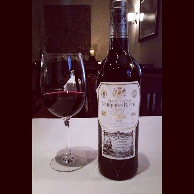The Herederos del Marques de Riscal 2008 Reserva Tempranillo blend is classically savory with notes of dark berries and toasty oak best with our Double cut Pork Chop. @marquesderiscal #WineDownThursday