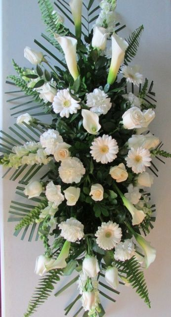 Sympathy Flowers/ White roses/ White calla lilies/ White carnations/ White gerber dasies/ www.callaraesfloralevents.com