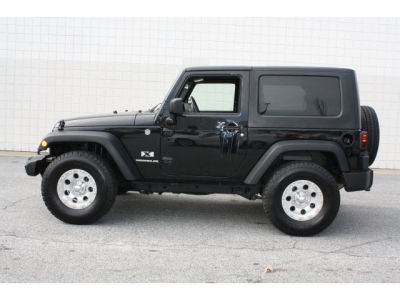 Black Knight  2009   40,782 Miles 17,144  Black Clearcoat, 2 door, 4WD, SUV, Automatic, 3.8L V6 12V MPFI OHV, Stock# 8156B.  Dealer: Heritage Volkswagen of Lithia Springs  no power windows
