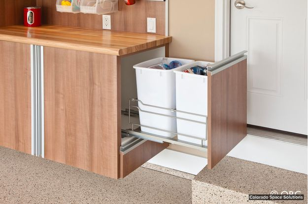 Install a rolling recycling bin in your kitchen counter or island. | 42 Ingeniously Easy Ways To Hide The Ugly Stuff In Your Home