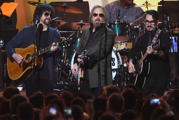 Tom Petty Photos - (L-R) Jeff Lynne, Tom Petty, and Dhani Harrison perform during the 2017 MusiCares Person of the Year, honouring Tom Petty, in Los Angeles, Clifornia on February 10, 2017.  / AFP / Robyn BECK - 59th Grammy Awards - MusiCares Person of the Year  - Show