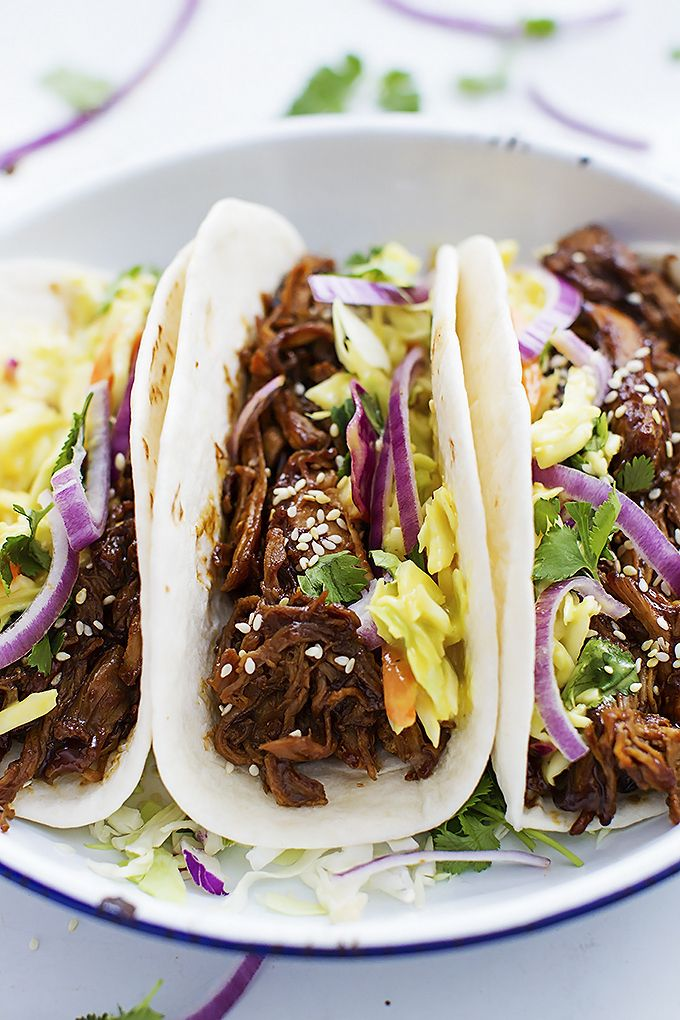 Juicy slow cooked shredded pork slathered in Korean bbq sauce, topped with creamy slaw, and wrapped in taco shells! From @cremedelacrumb #FrenchsSweetAndSpicy