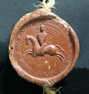 Reitersiegel Heinrichs VII. († 1242) als Herzog von Schwaben, 1220: Auf dem Schild findet sich die älteste bekannte Darstellung des staufischen Dreilöwenwappens.  (StAS FAS DS 39 T 1-3 U 6)