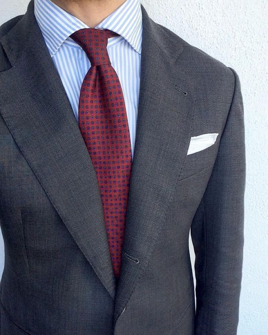Dark grey suit, white shirt with light blue candy stripes ...
