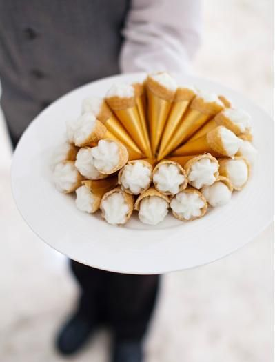 winter wedding food.  Cannoli wrapped in gold.  Served at cocktail hour.
