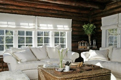 Rich log detail + White decor by kml design Trim color contrast is lively with the cabin logs.