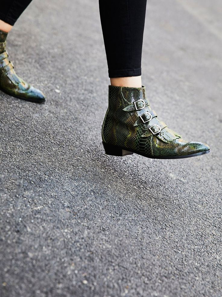 Jett Snake Boot   Made in NYC, these sleek and shiny ankle boots feature a snakeskin design with refined buckles and a loafer-inspired fringe over the top of the foot.    * Side zipper closure * So subtle chunky block heel