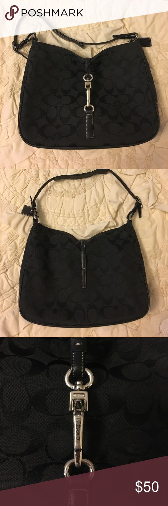 Black Coach Purse Previously loved and very well maintained black Coach  purse. Silver metal clasp and completely authentic. Coach Bags Shoulder Bags