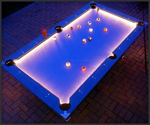"""This would be cool to have - """"Outdoor Pool Table' : Not only is this pool table water- and weather-proof so you can play outdoors year-round, but it offers a brightly lit glowing tabletop and pockets for those all-night 8-ball marathons."""