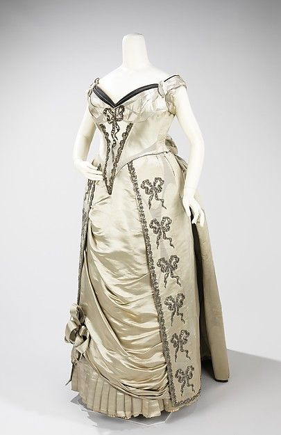 Evening dress Design House: House of Worth  (French, 1858–1956) Designer: Charles Frederick Worth (French (born England), Bourne 1825–1895 Paris) Date: 1888 Culture: French Medium: silk, metal Dimensions: Length at CB (a): 23 in. (58.4 cm) Length at CB (b): 50 in. (127 cm) Credit Line: Brooklyn Museum Costume Collection at The Metropolitan Museum of Art, Gift of the Brooklyn Museum, 2009; Gift of the Princess Viggo in accordance with the wishes of the Misses Hewitt, 1931