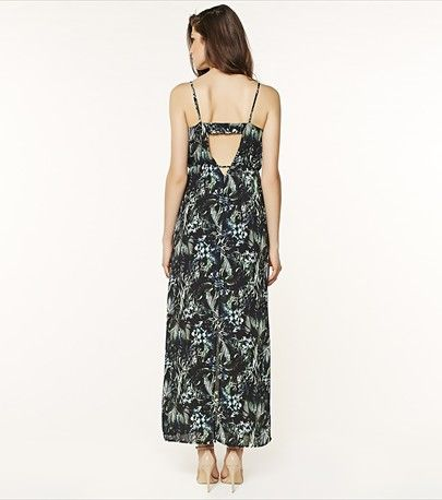 Stun in the sun with this maxi tropical print dress featuring a sexy back cut out!
