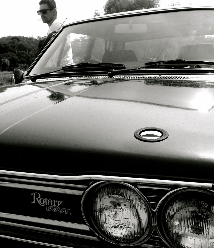 The wheel man... Henri H division Bourse.  Datsun 510 1600, Rotary Engine, Forest Green. A thing of beauty...