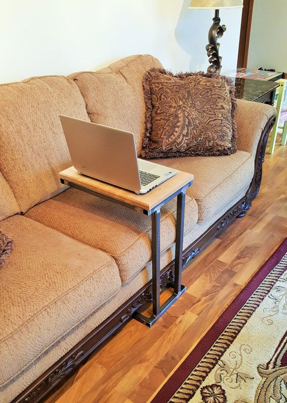 Modern table. Pulling up to the couch and use as a table for drinks, book, computer etc.  Wood dimensions - 18L by 12 W Material : Square tubing - 1 by