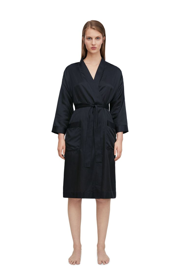 """<p style=""""text-align: justify;"""">In lightweight silk-cotton blend, this refined satin robe has a knee-brushing length. A relaxed fit with wide, slightly crop"""