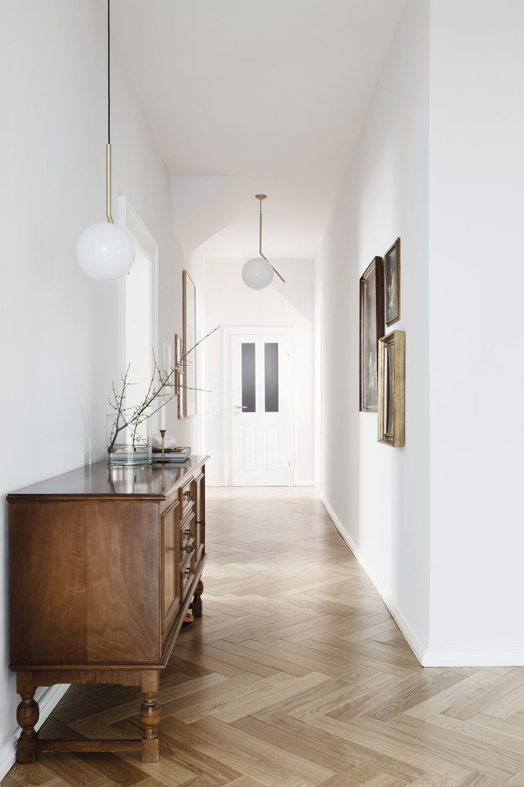Tricks of the trade. Interesting to see this lovely chevron oak floor running widthways rather than towards the door. This gives the hall more breadth.