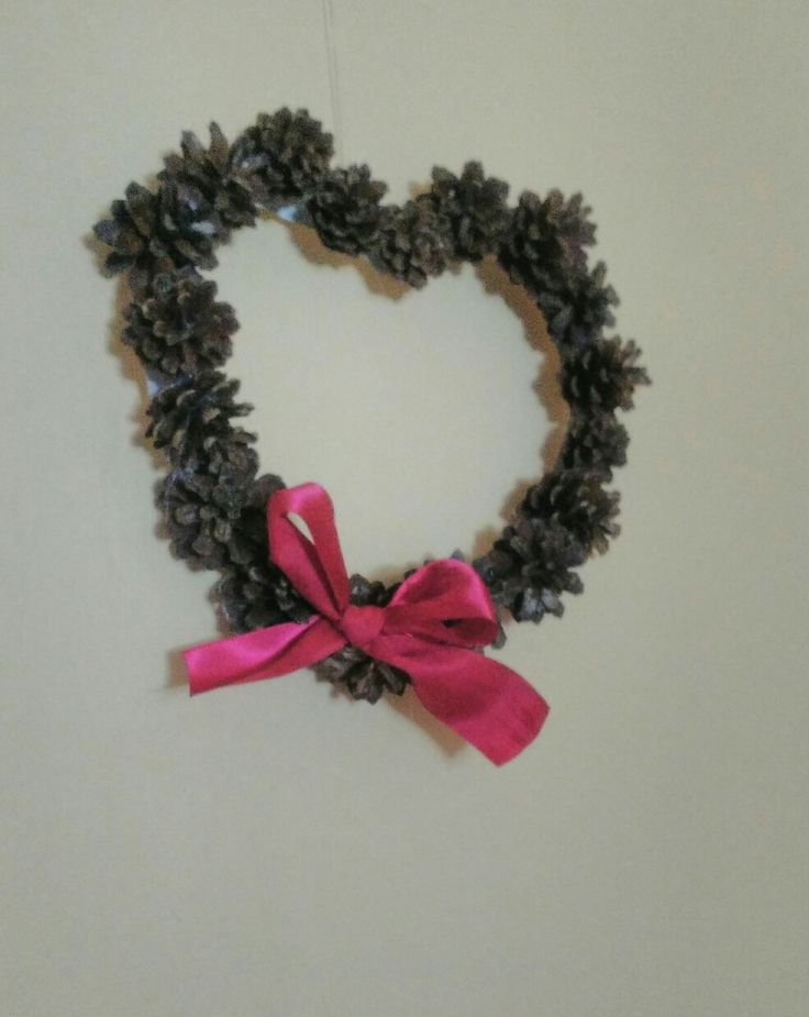 Pinecone wreath with a ribbon. Heart shaped wreath.