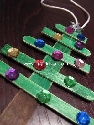 Kids make Christmas Tree ornaments out of popsicle sticks and sequins