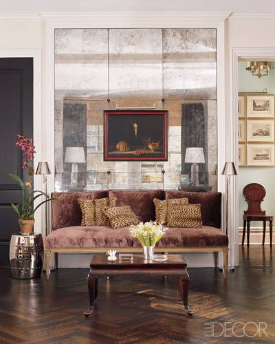 Smoke And  Mirrors--   In the living room of his Manhattan home, interior designer Todd Romano created a wall of antique mirrored mercury-glass panels that serves as a backdrop for the seating area as well as for a 1950s still-life painting. The Louis XVI banquette and antique Chinese lacquered table add to the old-world glamour of the space.