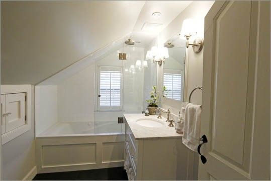 Bathtub under the eaves only more narrow a bathroom for Small bathroom with sloped ceiling