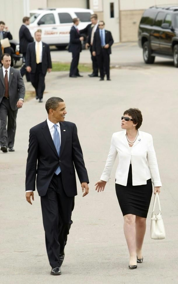 This was .. Obama's 100th day in office. U.S. President Barack Obama and senior White House advisor Valerie Jarrett walk together after Obama held a town hall meeting held at Fox Senior High School in Arnold, Missouri, April 29, 2009.