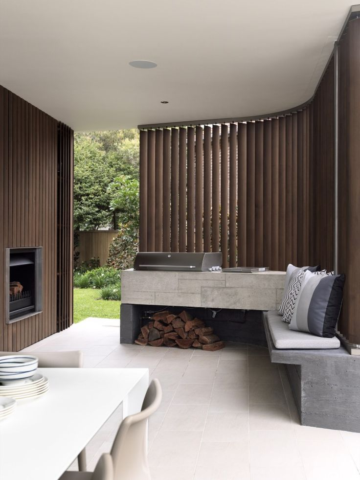 Fireplace + Curved timber screen + Concrete seat - Balcony Over Bronte / Luigi Rosselli Architects