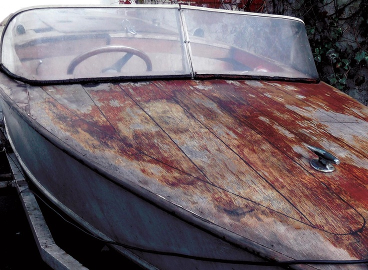 Worn and Flaking Varnish on this 60's speed boat. The