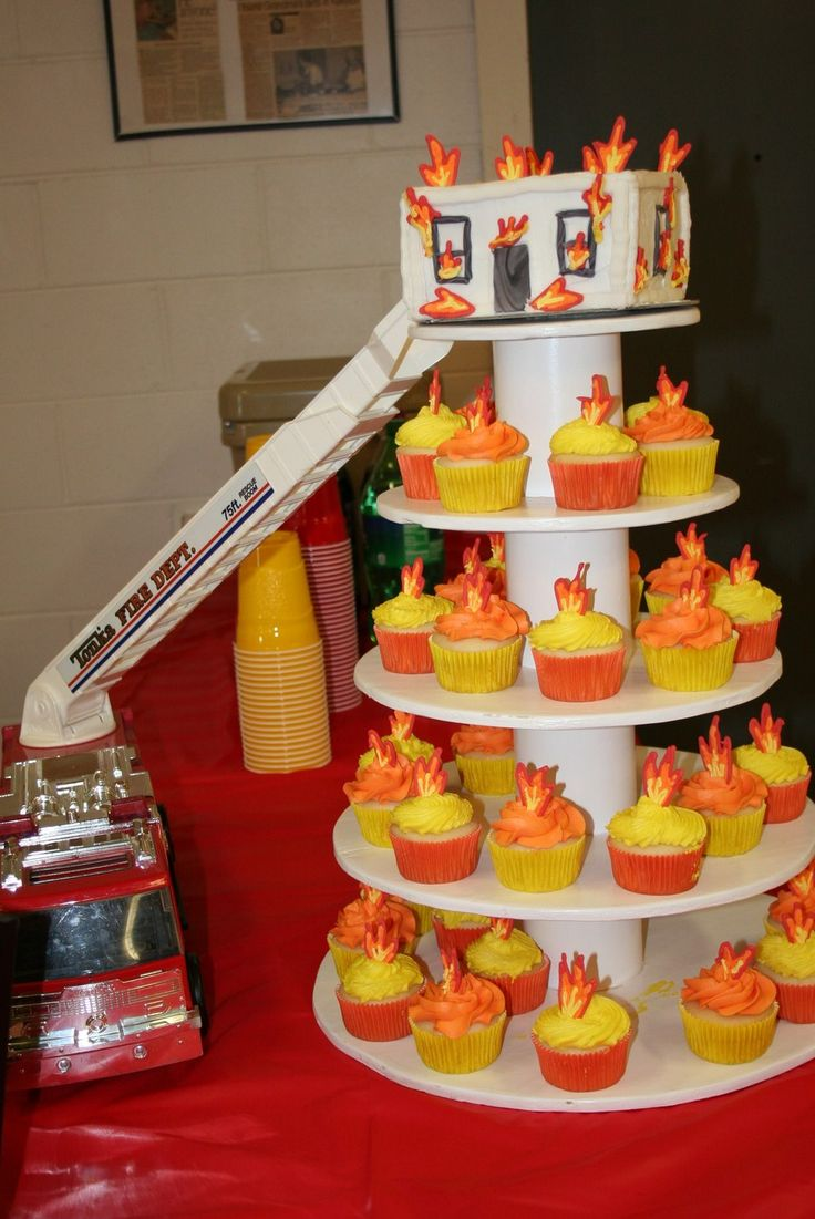 Fireman Burning house cake with flame cupcakes for groom's party.