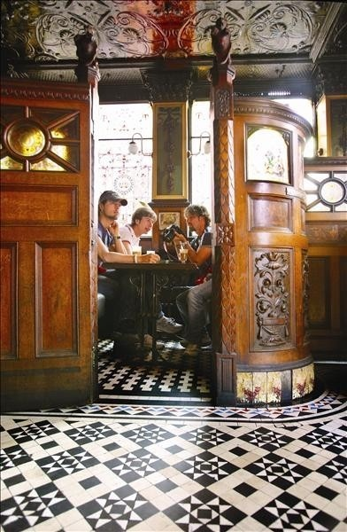 Interior or The Crown Bar Saloon in Belfast. Tempting way to pass an afternoon. Love the floor.
