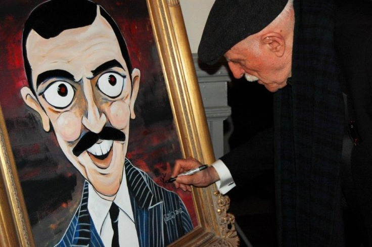 """TISH! THAT'S FRENCH!"" by Mark Redfield being signed by John Astin in 2012"