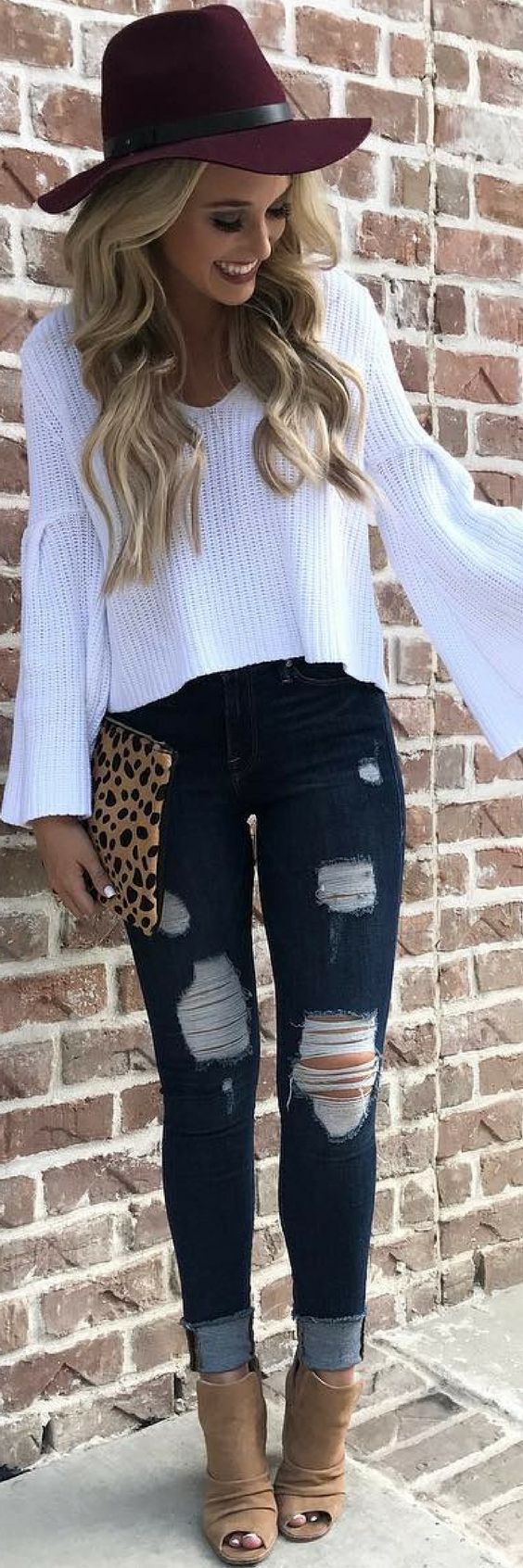 Fall outfit paired with ripped jeans