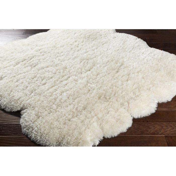 The Loon Peak Sheep collection offers a contrast from conventional flat rugs by adding a textural aesthetic and soft, plush comfort that stimulates the senses and completes the look. Made from 100% polyester, this trendy faux sheepskin will complement any space! The influence for these magnificent machine made rugs stems from the hues, patterns, and constructions of hand made pieces, allowing for a fashionable, affordable look. Made using a complex process with large machines collectively…