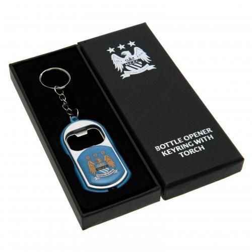 MANCHESTER CITY Bottle Opener keyring with torch all in one. Approx 7 cm x 3.5 cm in size. In a gift box. Official Licensed Manchester City merchandise. FREE DELIVERY