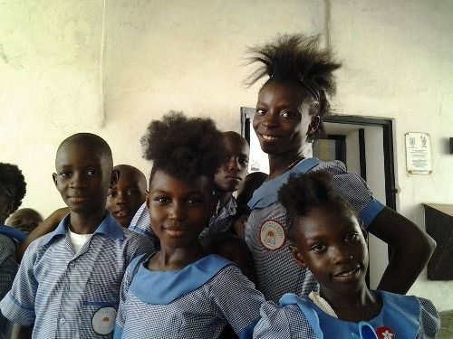 Liberian schoolchildren from a nearby refugee camp visiting the Cape Coast Dungeon (Ghana) to learn about the slave trade. The girls told us their hairstyle is called