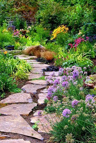 Flagstone path with perennial garden border outdoor for Garden path stones