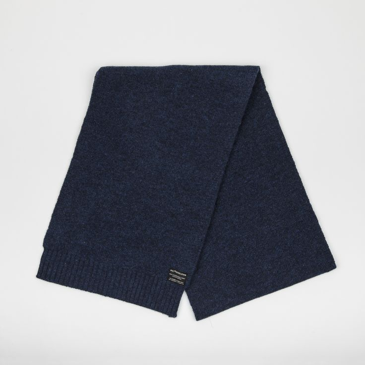 Navy: Heavy knit scarf made of a soft melange look wool blend, has the RVLT brand label.