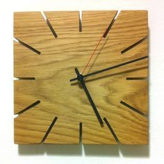 A simple stylish and contemporary handmade clock, perfect for anywhere in the home.This clock draws inspiration from the sundial, saw cuts are positioned where the numbers normally are. From time to time, you can watch the clock hands result in a line with the hour and minutes position. Handmade in the UK by very highly skilled craftsmen, to an extremely high standard.Solid Oak German made Quartz clock movement inlaid into the back of the clock - so it sits flush to the wall. Takes 1 x aa…
