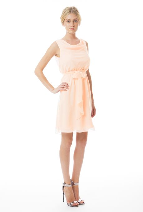 """Brides.com: Trending Now: Pretty Peach Bridesmaid Dresses. """"Heather"""" short bridesmaid dress in Paradise City, $235, Ceremony by Joanna August"""