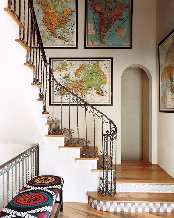 Another way to show off your love of travel is by framing maps. We're particularly fond of vintage ones.  Source: Domino Magazine