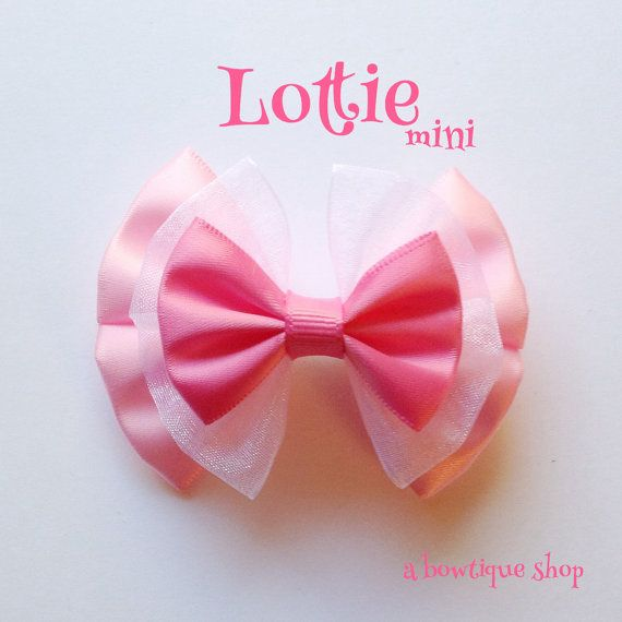Up for your consideration is a custom made Lottie mini hair bow.  The bow measures 3 inches wide. This bow comes with an alligator clip attached.  I also have a large version of this bow listed.  Thanks for looking!  *All items contain small parts that would be considered a choking hazard.