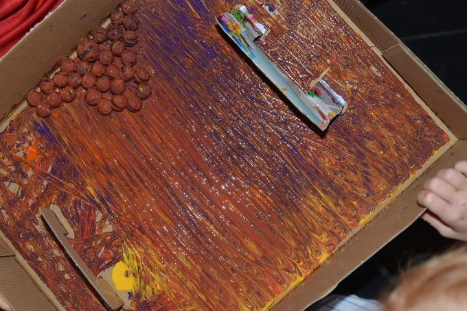 Easy Marble Painting activity, great for preschool or early years science or crafts.