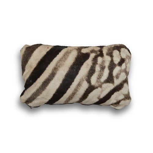 This Zebra Hide Pillow adds instant exotic drama with its luxurious texture and natural pattern. Sure to add impact to your seated area. This product is CITES approved (Convention on International Trade of Endangered Species) and is handmade in South Africa