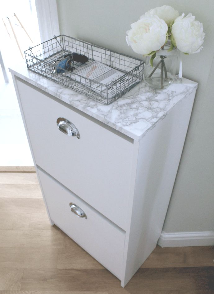 """IKEA BISSA shoe cabinet Hack - Easy """"hack"""" ideas? Oversized wall decals on the front, washi tape to make stripes, contact paper for the top, handles (brass ring pulls or curved pulls like these) to make it look more like a piece of furniture."""