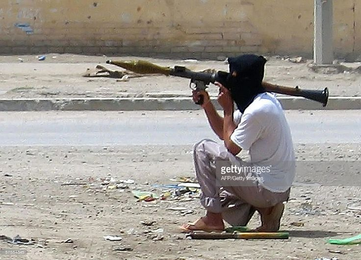 A masked Iraqi insurgent holds an RPG during clashes in the restive city of Ramadi, 100 west of Baghdad, 07 May 2006. A US marine died today after he was wounded in an attack in the restive province of Al-Anbar in western Iraq, the American military said.