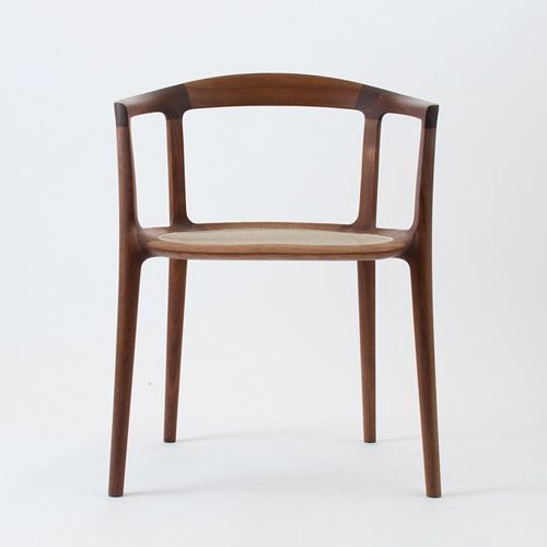 I love the clean, smooth lines of this chair. And I'm into woods. But the best part of this chair is it's light, airy quality. This would be perfect in a small space.