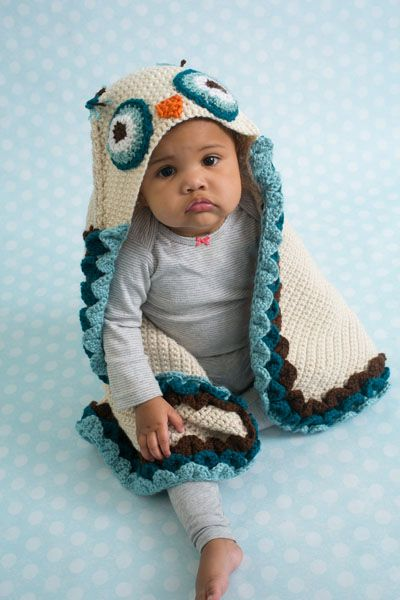 Owl Hooded Blanket - When it's naptime, cover up your little cutie with the Owl Hooded Blanket. This cozy blanket features an attached owl hood and feather details to give the appearance of wings. Created with soft baby-approved yarn, this is the perfect naptime accessory. From the August 2015 issue of I Like Crochet