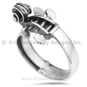 Cello Ring - This ring takes its artistic form from a cello. The scrollwork on the head and fingerboard are exactly to proportion. $1400 - 2700.