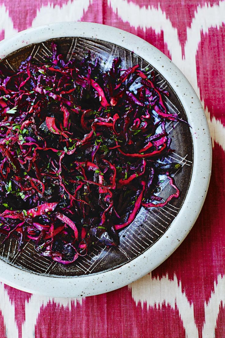 This brightly-coloured, no-cook Persian salad makes a fun and flavoursome  accompaniment to a roast chicken.   Crunchy raw cabbage is an everyday feature of salads in Iran and here red  cabbage is combined with raw beetroot and dates for a sweet and healthy  take on a winter 'slaw. Quicker, lighter and less fuss than your usual  roast dinner veggies, a salad means less time in the kitchen and more time  for autumnal walks.   SERVES 4 AS A SIDE   2 medium, raw beetroots, peeled and grated…