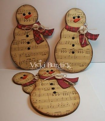 Music note snowman. Rather than using scrap booking paper, can print the design and brown the paper in the oven. Cut and dremel the snowman down. Maybe mod podge the pattern onto the design rather than glue and cuttlebug?