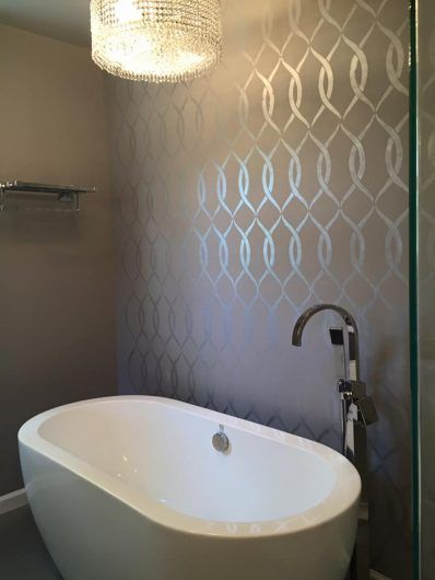 A DIY metallic stenciled bathroom accent wall using the Entwined Allover Stencil from Cutting Edge Stencils. http://www.cuttingedgestencils.com/stencil-pattern-2.html